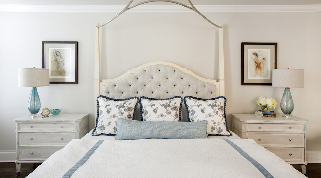 bedroom-accent-pillows-fabric-headboard-symmetrical-nightstands