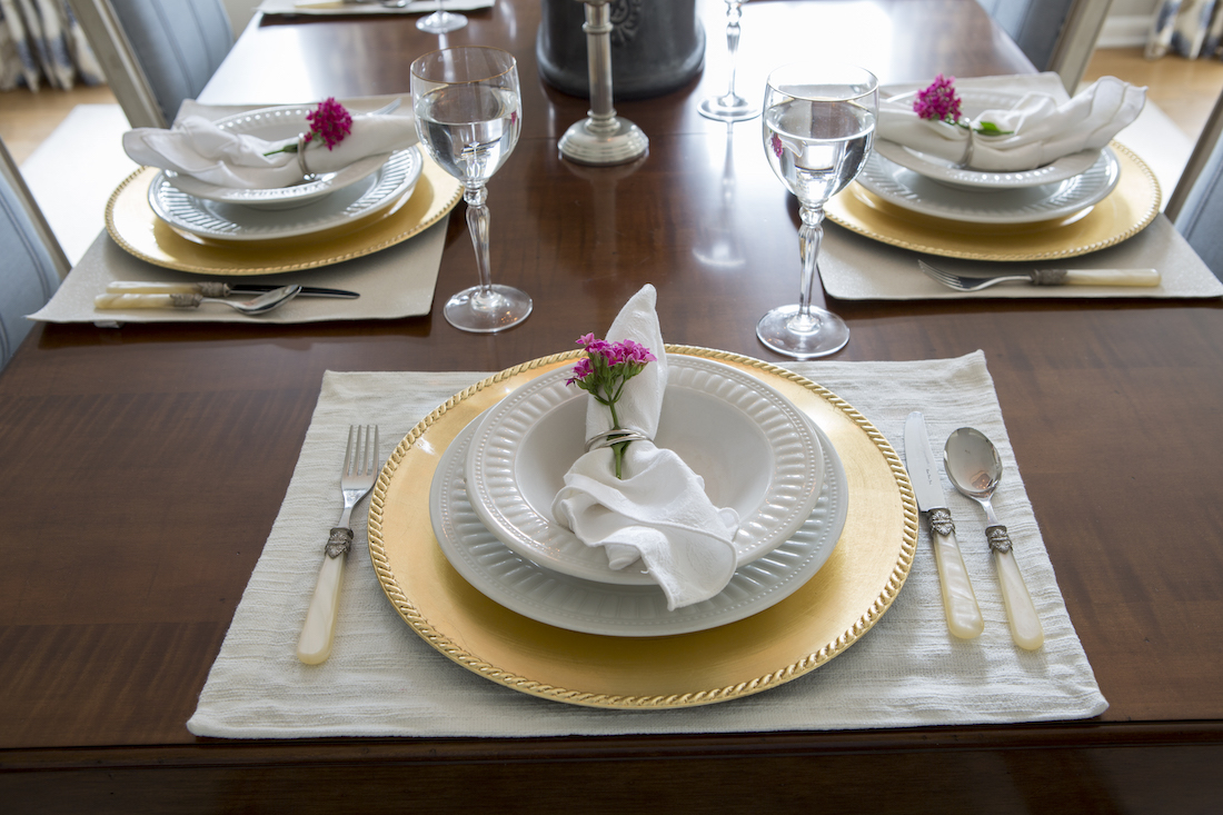 dining-table-setting-two-plates-napkin-rings-with-flowers