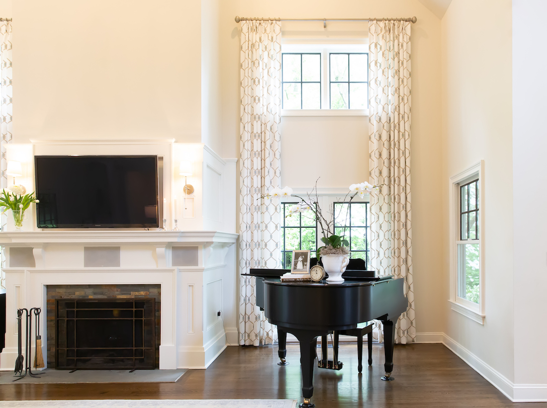 great-room-design-floor-to-ceiling-window-treatments-piano-fireplace