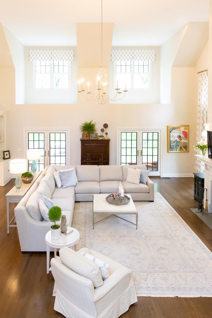 great-room-interior-design-l-shaped-sofa-black-window-panes