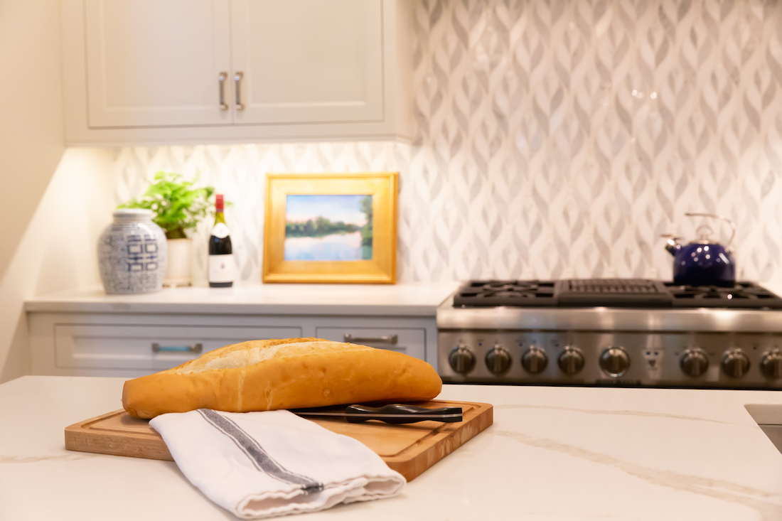 kitchen-interior-design-cutting-board-marble-countertops