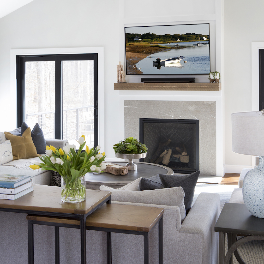 living-room-interior-design-stacking-tables-fireplace-wooden-mantel